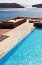 Pool And Terrace Over Mediterranean Sea(Greece) Royalty Free Stock Images - 26990099