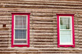 Red Framed Windows In Log House Wall Architecture Stock Photography - 26999012