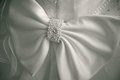 Big Bow On A Wedding Dress. Simple Background. Royalty Free Stock Images - 27038779