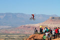 Mountain Biker Jumps Cliff And Crowd Watches Stock Image - 27052551