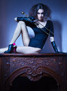 Beautiful Woman Sitting On Fireplace In Old House Stock Photography - 27053072