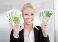 Businesswoman Holding Euro Currency Notes Stock Photo - 27066200
