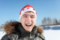 Young Man In Santa Hat Royalty Free Stock Photography - 27070847