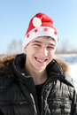 Young Man In Santa Hat Stock Photos - 27070903
