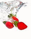 Three Strawberries Falling Royalty Free Stock Photography - 27106387
