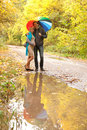 Happy Pregnant Woman And A Man Walking Royalty Free Stock Image - 27107396