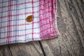 Striped Dish Cloth On Brown Wood Royalty Free Stock Image - 27110746
