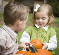 Cute Young Brother And Sister At The Pumpkin Patch Royalty Free Stock Photo - 27115315