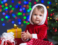Baby Santa Claus Near Christmas Tree With Gifts Royalty Free Stock Photo - 27132635