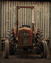 Old Tractor By Barn Royalty Free Stock Photo - 27165165