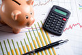 Calculator, Piggy Bank And Pen On Business Graph Royalty Free Stock Images - 27178349