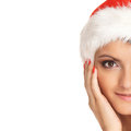 Portrait Of A Young Woman In A Christmas Hat Royalty Free Stock Photography - 27179987