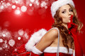 Sexy Woman Wearing Santa Clause Costume Royalty Free Stock Photos - 27185198