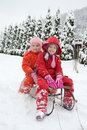 Little Girls Staying On The Sledge Stock Photos - 27186453