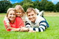 Joyous Family In A Park Enjoying Day Out Royalty Free Stock Images - 27195019
