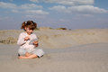 Little Girl Play With Tablet Pc In Desert Stock Photos - 27196513