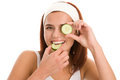 Woman With Slices Of Cucumber Stock Image - 27199461