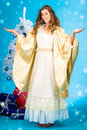 Traditional Christmas Angel In Front Of Tree Stock Image - 27225191