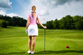 Young Female Golf Player On Course Royalty Free Stock Image - 27225296