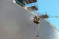 Worker Painting Of The Ship Royalty Free Stock Image - 27235286