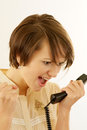 Angry Young Woman With A Phone Royalty Free Stock Photos - 27236108