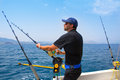 Blue Sea Fisherman In Trolling Boat With Downrigger Stock Image - 27237371