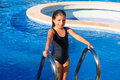 Children Girl On The Blue Pool Stairs Black Swimsuit Stock Photo - 27239110
