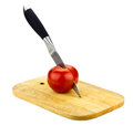 Tomato And Knife Stock Image - 27249331