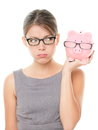 Upset Woman Wearing Glasses Holding Piggy Bank Stock Photography - 27258152