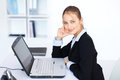 Young Smiling Business Woman Working On A Laptop Stock Image - 27266421