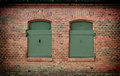Brick Wall And Old Steel Shutters Closed Stock Photos - 27302273