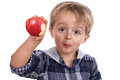 Boy Eating A Red Apple Stock Photography - 27308972