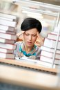 Tired Woman Surrounded With Books Royalty Free Stock Photography - 27366247
