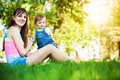 Funny Baby With Mom In A Greenl Summer Park Stock Image - 27384481