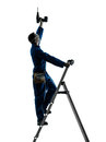 Man Construction Worker Holding Drill Silhouette Stock Photo - 27385860