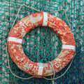 Old Weathered Lifebuoy On Wooden Wall Stock Photo - 27389340