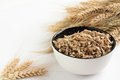Raw Flakes In A White Bowl And Ears Of Wheat Stock Photography - 27398912