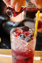 Drink With Fresh Fruit And Syrup Royalty Free Stock Photography - 27403847