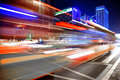 High Speed And Blurred Bus Light Trails In Downtown Nightscape Stock Photography - 27414682
