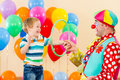 Clown Amusing Child Boy On Birthday Party Stock Photo - 27423520