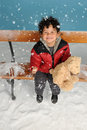Snowing On A Little Boy Stock Images - 27425754