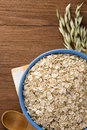 Oat Flakes In Bowl On Wood Royalty Free Stock Image - 27427296