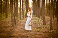 Beautiful Woman Standing In Forest Stock Photo - 27433270