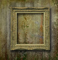 Golden Frame On Grunge Wood Wall Stock Photography - 27441002