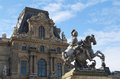 Louis XIV Statue With Louvre Palace Stock Photos - 27454563