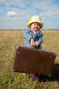 Lonely Girl With Suitcase Royalty Free Stock Photography - 27484557