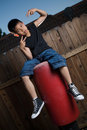 Sitting On A Punching Bag Royalty Free Stock Photo - 2756875