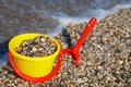 Plastic Spade And Bucket In Sand Royalty Free Stock Photography - 27515217