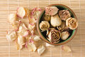 Dried Rosebuds In Teacup And Petals Top View Royalty Free Stock Image - 27544496