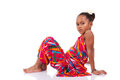 Cute Young African Asian Girl Seated On The Floor Stock Image - 27558561